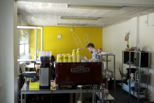 Serving coffee from the window of a co-working space on Hietalahdenkatu.