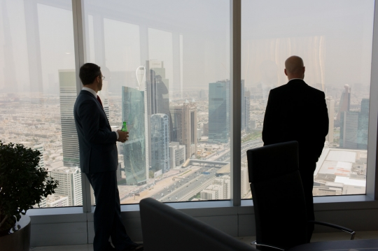 Noah and Justin survey Dubai from the PM's offices.