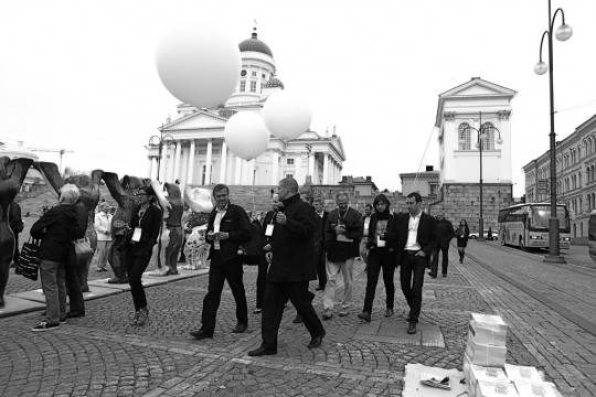 HDL guides with white balloon helping guests move between venues