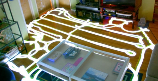 "A long-exposure photograph showing the human-recognizable path used by a Neato Robotics XV-11 to clean a room (Photo: <a href=""http://www.gearfuse.com/robotic-vacuum-paths-mapped-and-compared-with-long-exposure-pictures/"">Gearfuse</a>)"