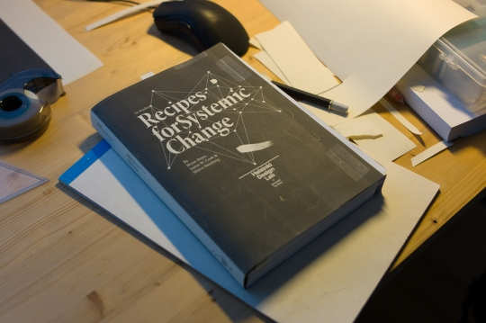 Mocking up the cover on a dummy book.