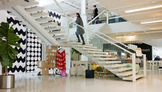 A grand stair in the entrance acts as a collection point for chance encounters as people come and go.